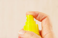 Female hand with yellow balloon of aerosol close up Royalty Free Stock Photo
