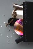 Female handbag with cosmetics. Over grey background Stock Photography