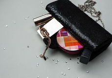 Female handbag with cosmetics. Over grey background Royalty Free Stock Images