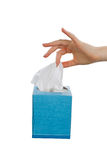 Female handing pulling soft facial tissue from napkin box Stock Photo