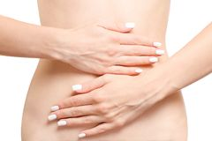 Female hands on abdomen hurts. On white background isolationlungs royalty free stock image