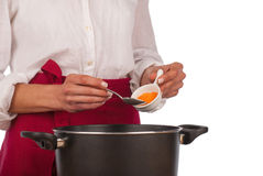 Cooking with curry at home Stock Images