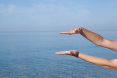 Female hands against sea background Royalty Free Stock Photo