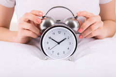 Female hands and alarm clock Stock Photo
