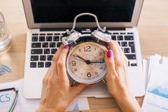 Female hands alarm Stock Photo