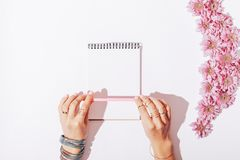 Free Female Hands And A Notebook With A Pink Pencil Stock Images - 107703594