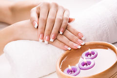 Woman's hands with aromatic candles and towel. Spa Stock Photos