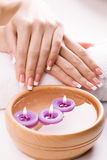 Hands with aromatic candles and towel. Spa Royalty Free Stock Photo