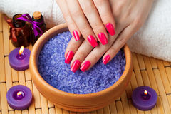 Female hands with aromatic candles and towel. Spa Stock Images