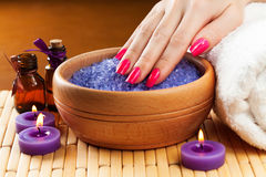 Female hands with aromatic candles and towel. Spa Stock Photography