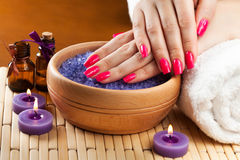 Female hands with aromatic candles and towel. Spa Stock Photo