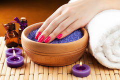 Female hands with aromatic candles and towel. Spa Royalty Free Stock Photo