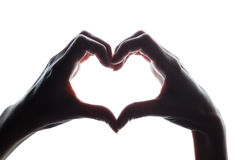 Female hands as a symbol of the heart. Horizontal silhouette royalty free stock photo