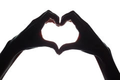 Female hands as a symbol of the heart. Horizontal silhouette royalty free stock images