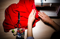 Female Hands At Work On Sewing Machine Stock Photo