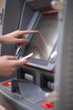 Female hands on the ATM display Stock Photography