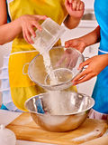 Female hands   baking cookies in kitchen Royalty Free Stock Image