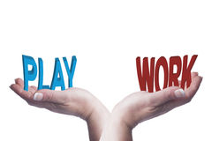 Female hands balancing work and play 3D words conceptual image Royalty Free Stock Photos