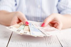 Female hands with banknotes give money Royalty Free Stock Photo
