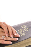Female hands on a bible Royalty Free Stock Photos