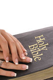 Female hands on a bible vertical Royalty Free Stock Photo