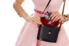 Female hands with black purse. Royalty Free Stock Photography