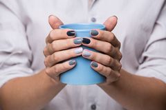 Female hands with blue cup Royalty Free Stock Photos