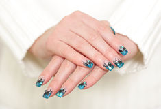 Female hands with blue manicure Stock Images