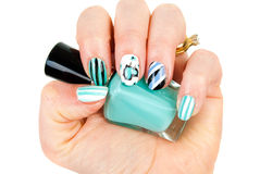 Female hands with blue modern manicure Stock Photo
