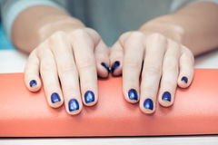 Female hands with  blue nail Polish, close-up Royalty Free Stock Image