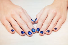 Female hands with  blue nail Polish, close-up Stock Image