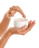 Female hands with body lotion Royalty Free Stock Photography
