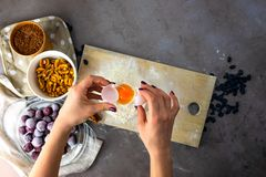 Baking ingredients on gray background. Female hands. stock photo