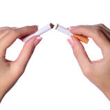 Female hands breaking a cigarette in two isolated on white. Stop Stock Photo