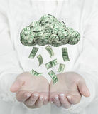 Female hands catching falling money from cloud. Stock Photos