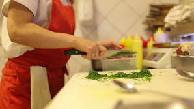Female hands chef cut fresh vegetables and dill stock video
