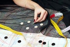 Female Hands Choosing Buttons Stock Photos