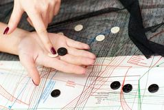 Female hands choosing buttons Stock Images