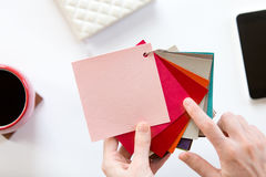 Female hands choosing a color fabric pattern Stock Images