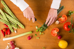 Female hands chopping leek Royalty Free Stock Photography