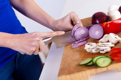 Female hands chopping vegetables on a wooden board Stock Photography