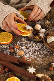 Female hands with christmas decoration. On a rustic wooden table Stock Photo