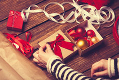 Female hands and christmas gift box Royalty Free Stock Photography
