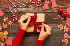 Female hands on christmas gift Stock Photos