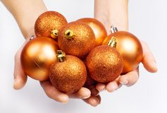 Female hands with Christmas spheres Royalty Free Stock Images