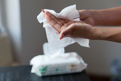 Female hands cleaning with wet wipes. Young woman cleaning hands with wet wipes stock images