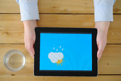 Female hands close up, the weather forecast on your tablet. Female hands close up, the weather forecast on your tablet Stock Photos
