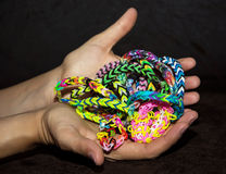 Female hands with colorful rubber bracelets Royalty Free Stock Photos