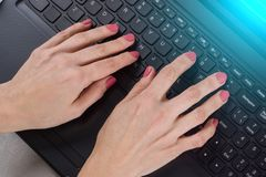 Female hands on the computer keyboard - business, education, programming, people and technology concept. Female hands on the computer keyboard - business stock image