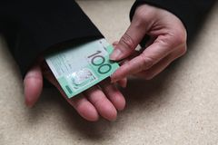 Female hands counting Australian 100 dollars bills Stock Image
